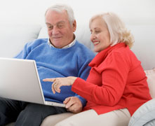 senior+couple+using+laptop