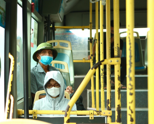 people masked on bus