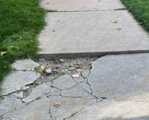 Broken sidewalk