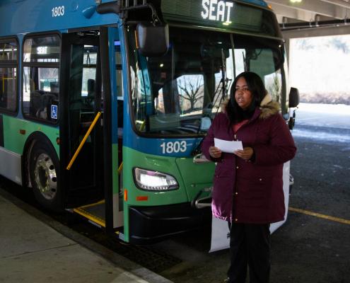 Woman standing near bus