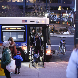 Person with disability getting off bus