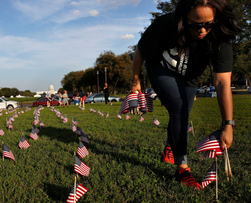 Woman putting Flags in ground