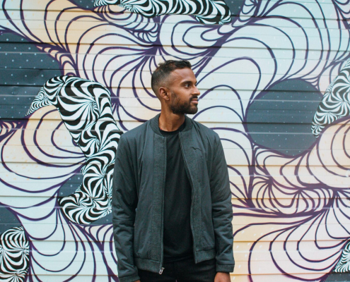Man standing in front of mural