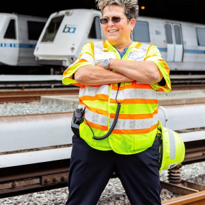 Woman worker in front of lightrail